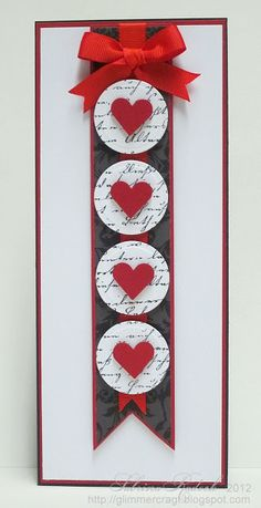 handmade Valentine ... tall and thin format ... long fishtail banner ... circles stamped with script and topped with hearts ... perfect red bow ... great card!!