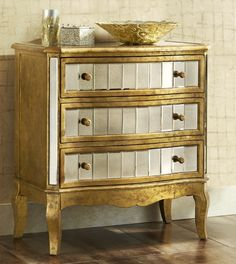 Pier 1's Crisanto Hall Chest is a streamlined bombe shape covered in gilt color