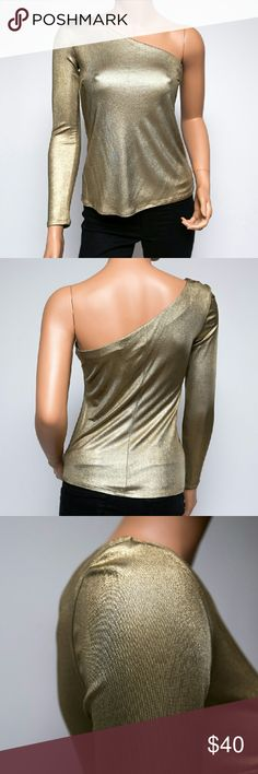 Trina Turk Metallic Bronze Long Sleeve Top Good condition; the only wear it shows is a small 'spot' on the arm where the color is a bit darker than the rest of the top; I'm not sure what it's from since it didn't come out with laundering, but in any case, since it's a dressy, low-lit evening sort of top, it wouldn't bother me to wear it as is. I've taken three photos of the area where the spot is, but because the top is so shiny, I had a very hard time capturing it. It is made in the USA…