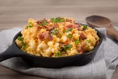 Loaded Instant Pot Mac and Cheese Recipe: Piping hot elbow macaroni swimming in creamy cheddar cheese sauce. Sprinkled with buttery toasted golden breadcrumbs, smoky crispy bacon bits, and crunchy scallions. Indulge in this ultimate kid-friendly comfort food.