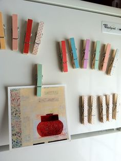 DIY: masking tape on the front of clothespins and magnet tape on the back!
