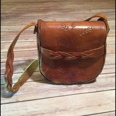 Vintage Saddle Bag Gorgeous Antique leather handmade saddle bag!! Braided shoulder strap with braided front strap. Leaf and Flower detail engraved in the leather. Inside has a red divider. For as vintage as this is this bag is in Excellent condition!!!! PRICE FIRM Bags