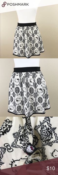 """🔴Hello Kitty black and white skater skirt sz S Like new Hello Kitty skater skirt. Size small. Made of 100% rayon. Very soft. Measures 27"""" waist with elastic waist band. 15 1/2"""" length. 😻 Hello Kitty Skirts Circle & Skater"""