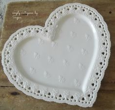 Heart-shaped plate would be pretty hung on the wall, maybe with ribbon?