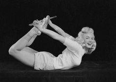 """In 1948, Marilyn Monroe posed for photographer Ed Cronenweth in a series of photos for Columbia Pictures. The caption on the back of the images read: """"Look pretty, feel good. Marilyn Monroe who plays the ingenue lead in Columbia's Ladies of the Chorus exercises her way to beauty and health."""" They were published in various newspapers promoting the movie."""