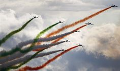Members of the Italian Air Force Frecce Tricolori aerobatic team perform during the Red Bull AirPower airshow in Zeltweg in the Austrian province of Styria.