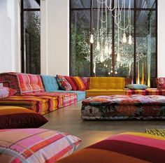 A typical Moroccan living room seating. All the seats are connected so you can have a close interaction with your guests. I miss this a lot! Will incorporate into my new home.