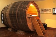 This hotel bed is a giant beer barrel.