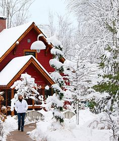 Snow-covered cottages at Michigan's Crystal Mountain Resort and Spa, one of our favorite Midwest ski resorts. Click for story!