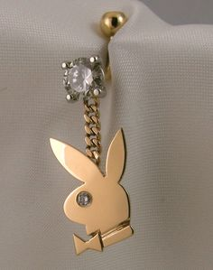 An unusual order: diamond and gold playboy bunny- belly button ring ;) brucewilsondesign.com