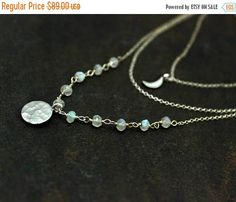 DESCRIPTION Multi Layer necklace with a rainbow moonstone wire wrapped chain and a delicate full and quarter moons. This can be made in your choice of 925 sterling silver or 14k gold filled chain.  CLASP Spring Ring  MEASUREMENTS Adjustable: The shortest chain is 13 inches The longest chain is 19 i