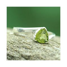 @Overstock - Peridot ringSterling silver jewelryClick here for ring sizing guidehttp://www.overstock.com/Worldstock-Fair-Trade/Sterling-Silver-Scintillating-Jaipur-Peridot-Ring-India/7005183/product.html?CID=214117 $40.99