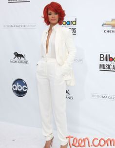 Rihanna in a white suit