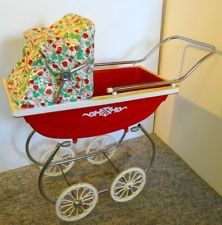 vintage toy baby carriage. I had this when I was 3! (not the same colors tho)