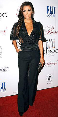 Eva wears a Zuhair Murad ensemble of plunging, beaded top and wide-leg tuxedo trousers