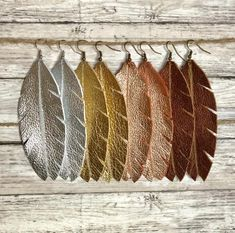 Fashionable feather shaped genuine leather earrings that are super light weight! You choose color Fashionable feather shaped genuine leather earrings that are super light weight! You choose color Diy Earrings Tools, Earrings Handmade, Handmade Jewelry, Heart Jewelry, Fine Jewelry, Jewelry Making, Jewellery Box, Diy Leather Earrings, Leather Jewelry