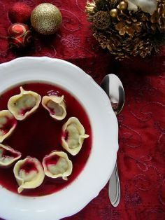 """Poland // """"Barszcz with Uszka"""" - a classic Polish Christmas starter is a beetroot soup with small dumplings, like dim-sum added in for extra flavour Polish Christmas, Christmas Meals, Christmas Eve, Christmas Starters, Beetroot Soup, Borscht, Polish Recipes, Polish Food, Dim Sum"""