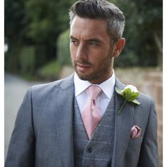 Love this grey lounge suit with a tweed waistcoat for the groom!