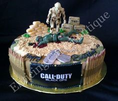 call of duty fondant camoflauge cake with sugar handmade bullets and dog tags. This is great for grooms cake or birthday cake