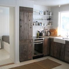 Utilize old wooden planks to build DIY kitchen cabinets