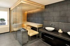 6+Luxury+Indoor+Saunas+12.jpg (470×313) - Love the stone walls! Would be a cool shower instead of a sauna.