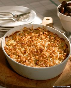 Jerusalem Artichoke Gratin ~ Jerusalem artichokes, also known as sunchokes, look a little bit like ginger root but have a sweet, nutty flavor and a similar texture to potatoes. Here, they are baked in creme fraiche and Gruyere cheese with Yukon gold potatoes, shallots, and chestnuts