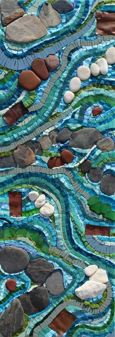 FLOWING MOSAIC £200  Smalti, pebbles, vitreous glass, porcelain, sicis glass, seashore glass, copper  21cm x 61cm   PURCHASING A MOSAIC You can purchase a piece of mosaic art by credit/debit card using PayPal or by cheque.   Smaller mosaics will be despatched professionally packaged by 1st class registered delivery upon receipt of payment. Larger pieces will be delivered by courier. All the prices quoted include the cost of delivery and packaging within the United Kingdom (please note we...