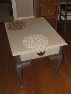 "Solid wood Broyhill end table painted in Mother Earth Chocoholic and Tanfastic, then stenciled on top with three 'mums'.  27"" by 22"" and 23"" tall.  For sale at reCHic Boutique and Decor in Mission, KS."