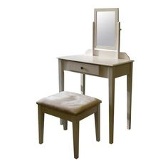 <p>The Ore International Vanity Set—Espresso is an attractive 3-pc. set made of composite wood with an espresso finish and includes a table, stool, and mirror. The table top surface is perfect for makeup, brushes or other accessories and includes a middle drawer for additional storage and organization. The elegant stool is topped with a white cushion offset by the deep espresso color of the table and legs. The titling mirror adds additional convenience. This beautifu...