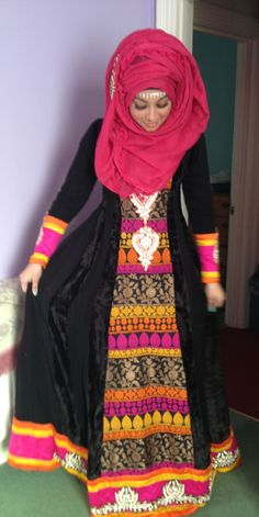 I LOVE this look, but why do some girls wear their hijabs so big like that? Anyway, she still looks beautiful.