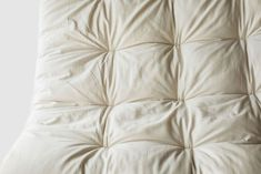 """Premium Eco-Wool Batting 100% Organic Cotton Sateen Fabric Handmade in USA Approximately 1.5-2"""" thick, perfect for adding a little softness. Since wool is the most breathable of all bedding materials, your body will love sleeping on top of an organic wool mattress topper. If you have a synthetic mattress, creating a natural sleeping surface is the best thing you can do for your body. Holy Lamb Organics hand crafts their organic wool toppers using Premium Eco-Wool batting tufted between 2… Natural Sleep, Natural Linen, Twin Cribs, Mattress, Lamb, Vermont, Design"""