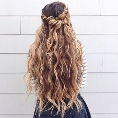 this is a perfect hairstyle if you have long hair. its always a struggle putting your hair up when its long and thick; this would be a perfect hairstyle with the beach curls and a twisted hair crown.