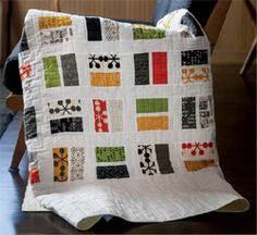 Play a Card quilt designed and quilted by Brigitte Heitland. Let fabric be your deck for this modern quilt.