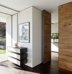 Epitome of modern rustic: Horizontal plank door, one wall of the horizontal planks; minimalist floating drawers   interior decorating ideas