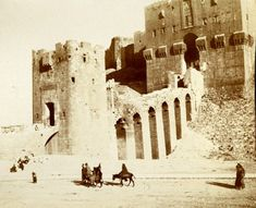 "Aleppo's Citadel in 1910. Photography by German photographer of the entrance to the citadel of Aleppo. ""The site of the town is like a cup and saucer, the houses lie in the saucer and the castle stands on the up-turned cup.."" Gertrude Bell, The Desert and the Sown 1907."