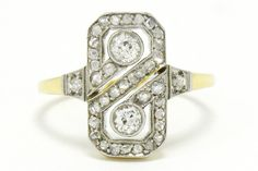 The Northridge Art Deco infinity two diamond engagement ring is set in an elegant 2 tone 18kt yellow gold and platinum low setting. This authentic antique twin bridal design centers on a pair of chunky, sparkling old mine cut diamonds surrounded by a bevy of rose cuts forming a geometric figure 8 motif. Eminently wearable, with a nice amount of finger coverage. #artdeco #engagementring #infinity #infinityring #2stonering #2stonerings #artdecoring #artdecorings #bridalring #bridalrings #ido #love Estate Engagement Ring, Antique Engagement Rings, Diamond Engagement Rings, Art Deco Ring, Bridal Rings, Diamond Cuts, 2 Carat, Gemstones, Jewelry