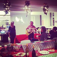 Christmas party at #edenspiekermann in Amsterdam! Hans on guitar, and Irene on vocals.