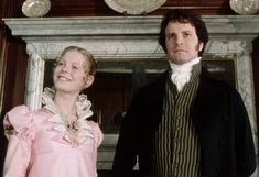 Georgiana Darcy and Mr. Darcy - Georgiana's lovely dress has buttoned down tabs, and an upstanding lace collar.