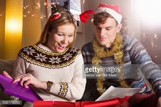 Stock Photo : Woman opening present at Christmas.