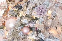 Holiday Living Room Tour blush gold flocked christmas tree blush wrapping paper pink christmas blush ornaments