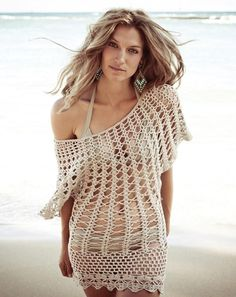 Crochet Coverup Make the beach your runway with this on-trend boho chic white swimsuit cover-up. Sleeveless design is accented by openwork crotchet-like patterns throughout that end in long elegant ragged edges. Wear wherever and whenever the day is hot and warrants a swimsuit, whether that's on the beach, on the streets, or by the poolside. Details : Color: Cream Style: Bikini Beach Cover Up 100% Cotton Pull On closure