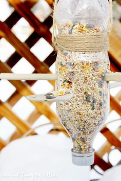 Make A Simple DIY Bird Feeder . Now this is too simple! Two Dollar Store spoons and a juice bottle.You can fill it by taking off the cap with a funnel. love it!