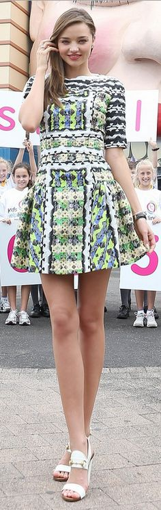 Who made  Miranda Kerr's white sandals and green print dress?