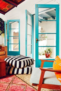 Open turquoise doors to living room