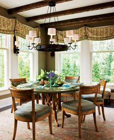 This expanded breakfast room by Mary Jo Donohoe and Donald Lococo lets the outdoors in. #interior #design #dining