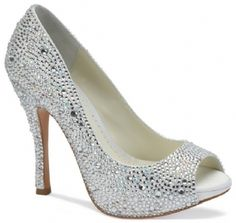 """Ivory Benjamin Adams Charley Bridal Shoes $399.00  JUNE 2013 DELIVERY - The New Benjamin Adams Charley style is the updated version of the famous Charlize design. The Charley has been updated to now incorporate a fully embellished crystal heel. Heel height measures 4 1/4"""". Available in Ivory."""