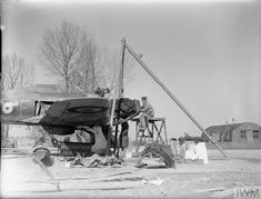 A replacement Rolls Royce Merlin engine being fitted into a Hawker Hurricane Mark I of No. 73 Squadron RAF at Rouvres. Rolls Royce Merlin, Hawker Hurricane, Emergency Power, Ww2 Planes, Photo Link, Royal Air Force, Museum Collection, World War Two, Wwii