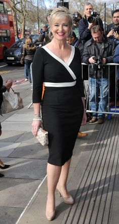 """Carol Kirkwood . 5'7"""". Wearing Diva Catwalk   Monochrome pencil dress made out of quality stretch fabric."""
