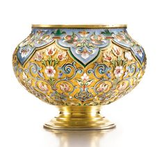A SILVER-GILT AND CLOISONNÉ ENAMEL BRATINA, KHLEBNIKOV, MOSCOW,  1899-1908    the surface painted with shaded polychrome formal foliage and blue scrolls on a stippled ground below green-bordered pale blue lambrequins, 84 standard, Dutch import mark. Click to enlarge. Source: http://www.sothebys.com/en/auctions/ecatalogue/2011/russian-works-of-art-faberg-and-icons/lot.553.lotnum.html