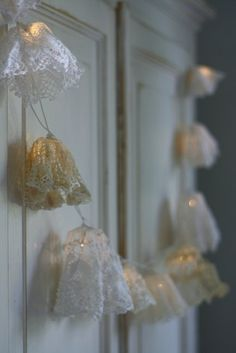 Lace garland ~❥ easy to do just gather lace , leave opening just big enough to push over the the Christmas lights , Think of all the party's or places you could use them